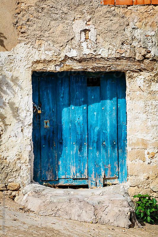 Antique Rural Blue Door by VICTOR TORRES for Stocksy United