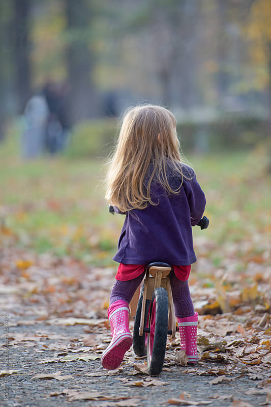 Young girl with pink boots and bicycle by RG&B Images for Stocksy United