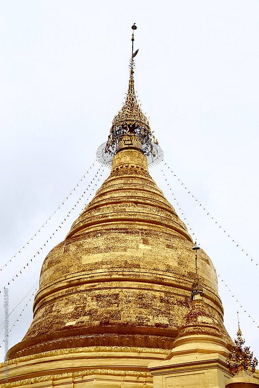 The top of a gold Buddhist temple Mandalay by Jaydene Chapman for Stocksy United