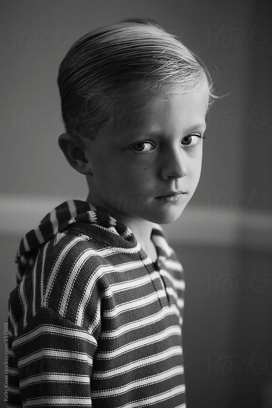black and white portrait of a boy by Kelly Knox for Stocksy United