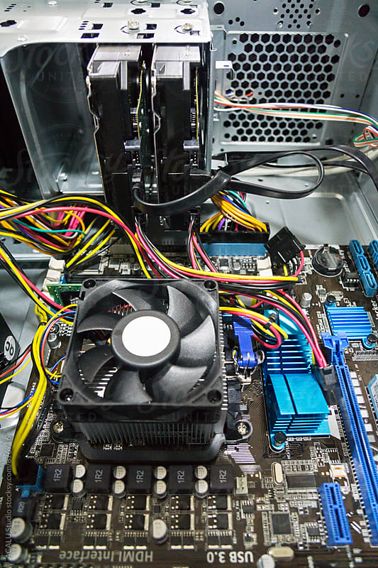 Open computer with motherboard by ACALU Studio for Stocksy United