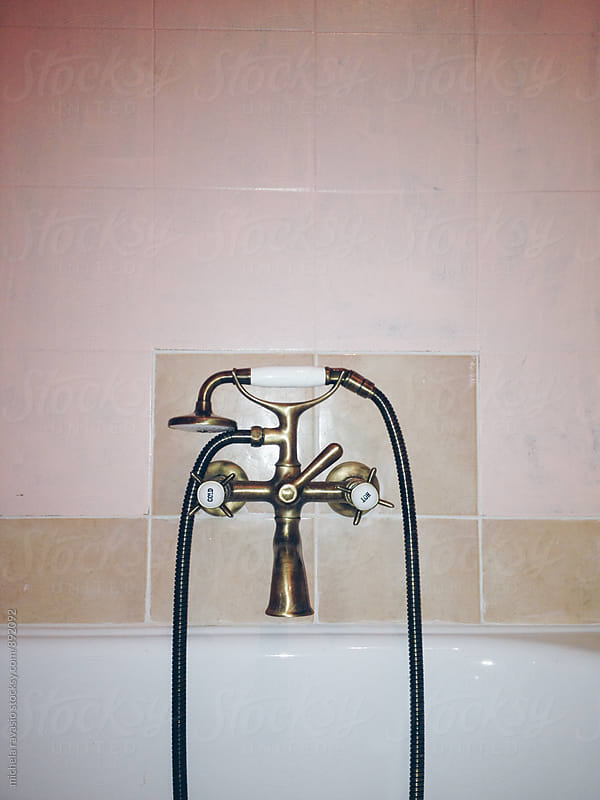 Old faucet of the bathtub by michela ravasio for Stocksy United