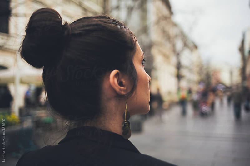 Woman With a Bun on the Street by Lumina for Stocksy United