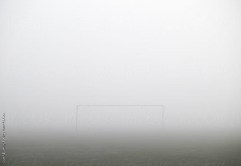 Football goal in thick fog by Jon Attaway for Stocksy United