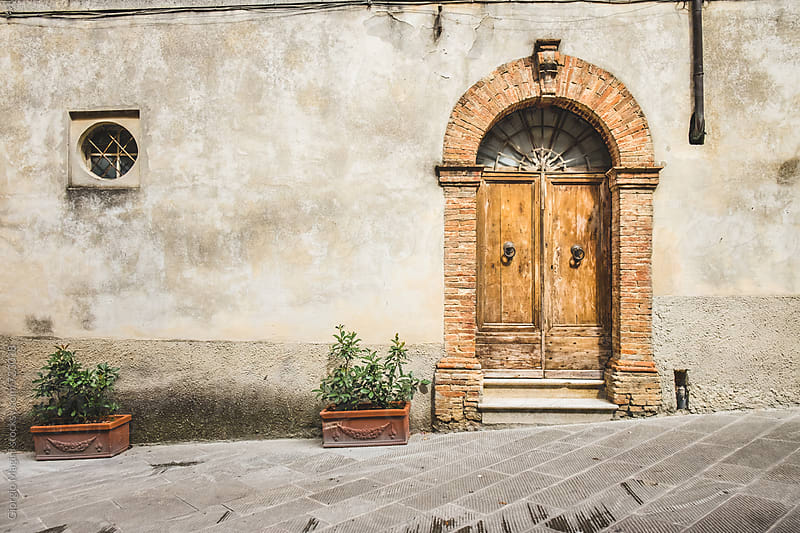Closed Wooden Door in an Old Tuscan Alley by Giorgio Magini for Stocksy United