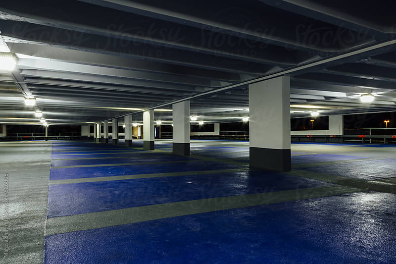 An empty car park at night by Maresa Smith for Stocksy United