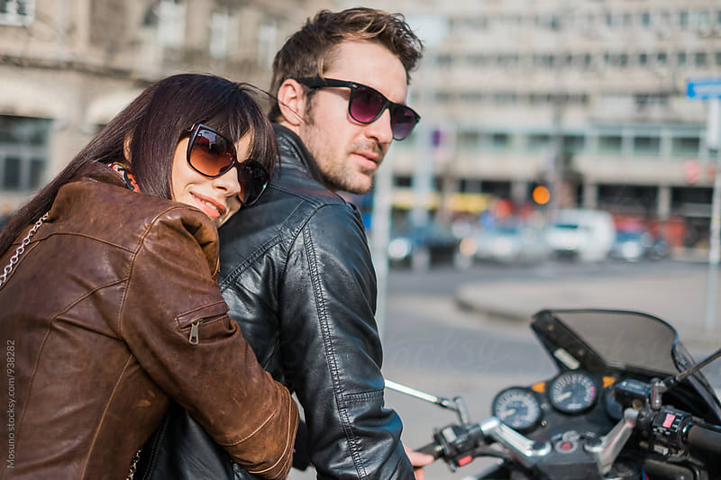 Happy Couple on a Motorcycle by Mosuno for Stocksy United