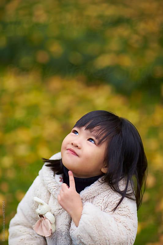 one little asian girl outdoor in the park by Bo Bo for Stocksy United