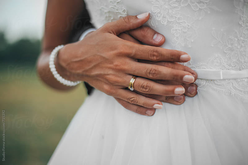 Hands of a Bride and Groom. by Studio Firma for Stocksy United