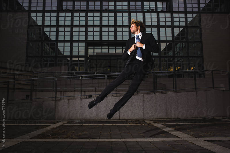 Young businessman floating in the air by michela ravasio for Stocksy United