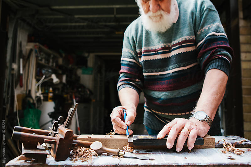 Senior man engaged in woodwork by kkgas for Stocksy United
