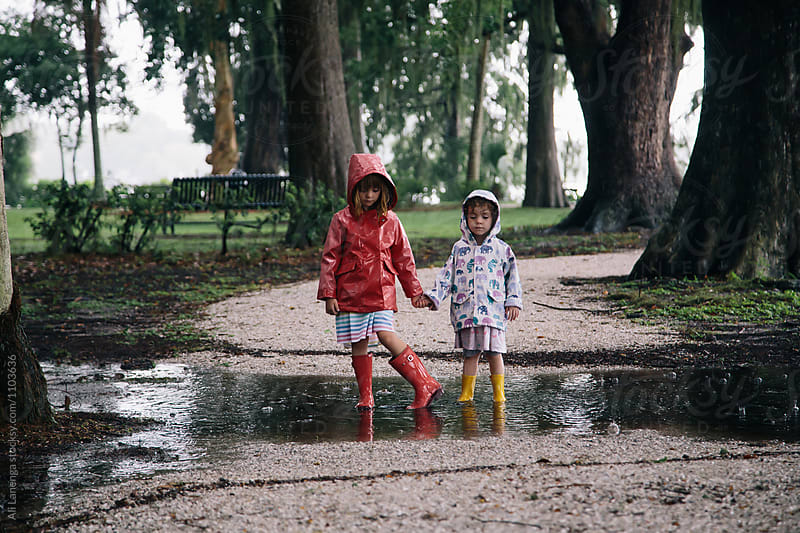 Children in the rain puddle