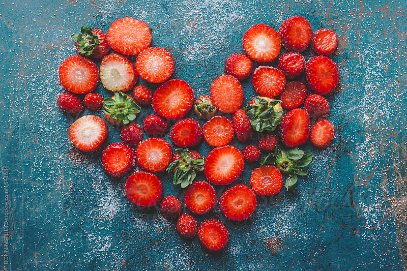 Strawberry heart on blue background. by BONNINSTUDIO for Stocksy United