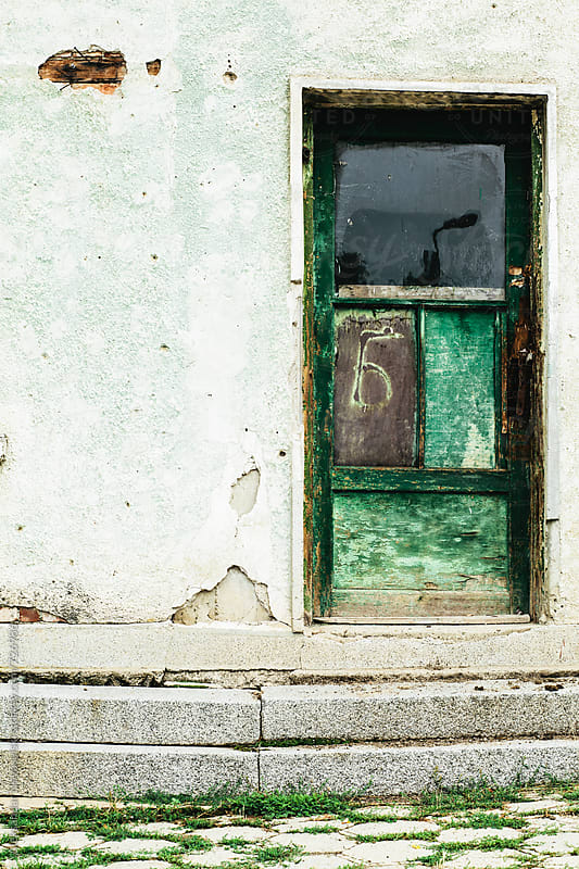 Green door and wall of an old building by Aleksandar Novoselski for Stocksy United