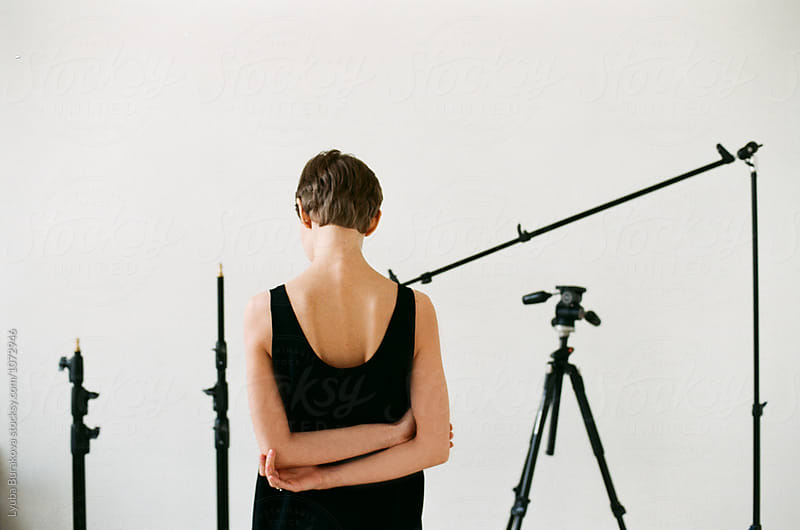 Back view of a woman in studio by Lyuba Burakova for Stocksy United