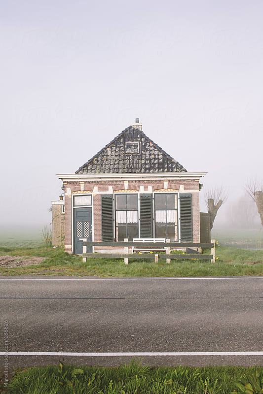 Old Dutch house next to a  road by Marcel for Stocksy United