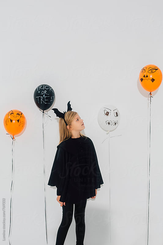 Blonde Witch and Halloween Balloons by Lumina for Stocksy United