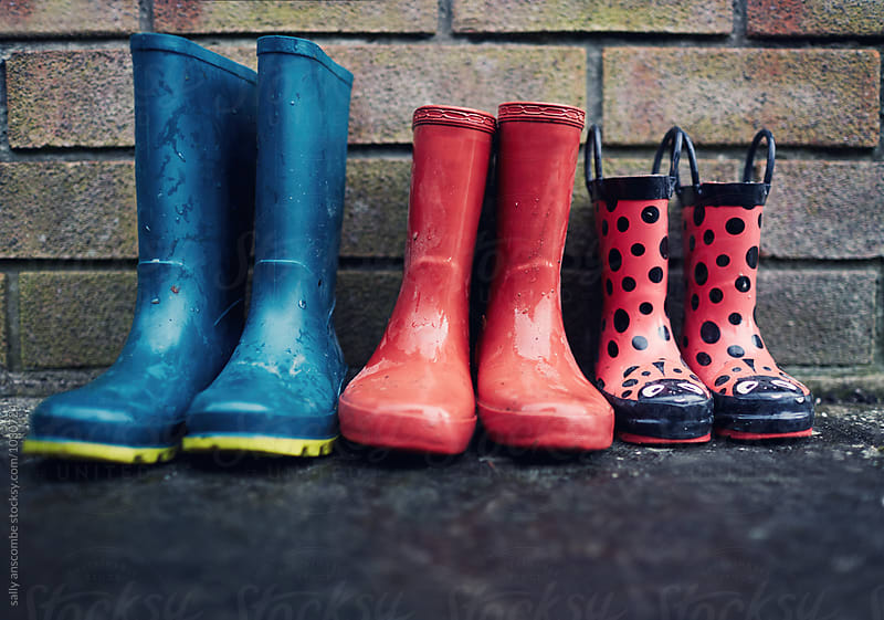 Wellington boots lined up  by sally anscombe for Stocksy United
