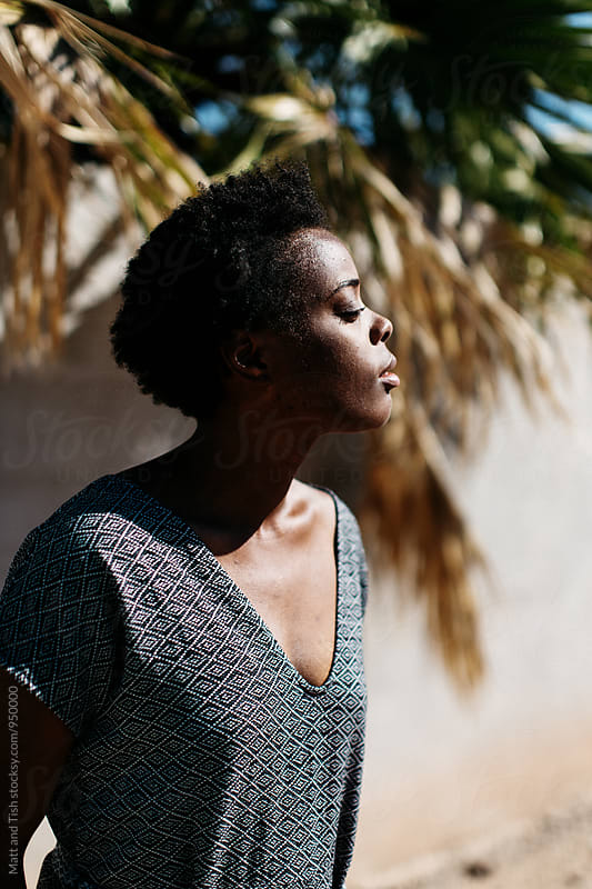 Black girl with Palm Trees by Matt and Tish for Stocksy United