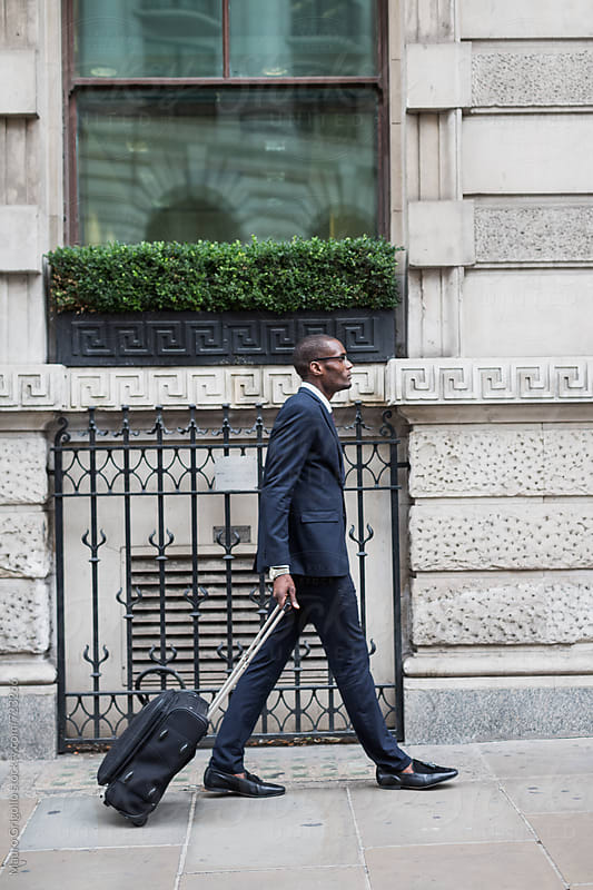 Modern afro businessman in the City by Mauro Grigollo for Stocksy United