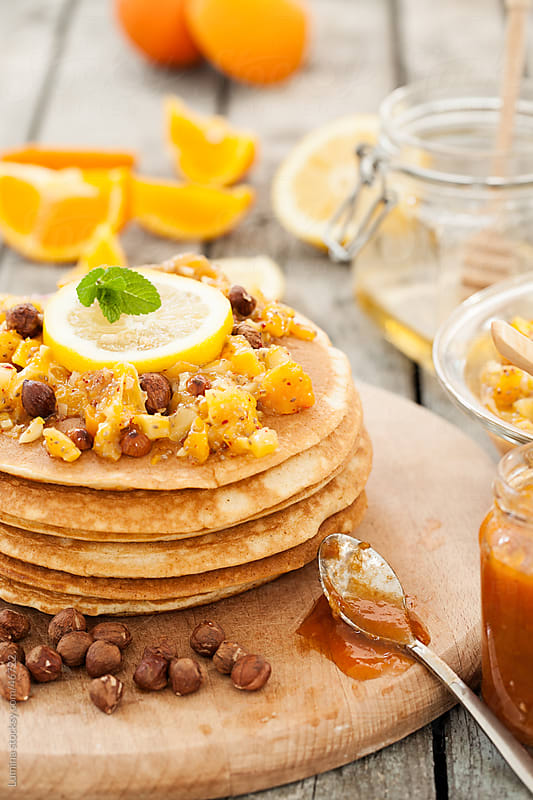 Pancakes with Orange and Hazelnut Topping  by Lumina for Stocksy United