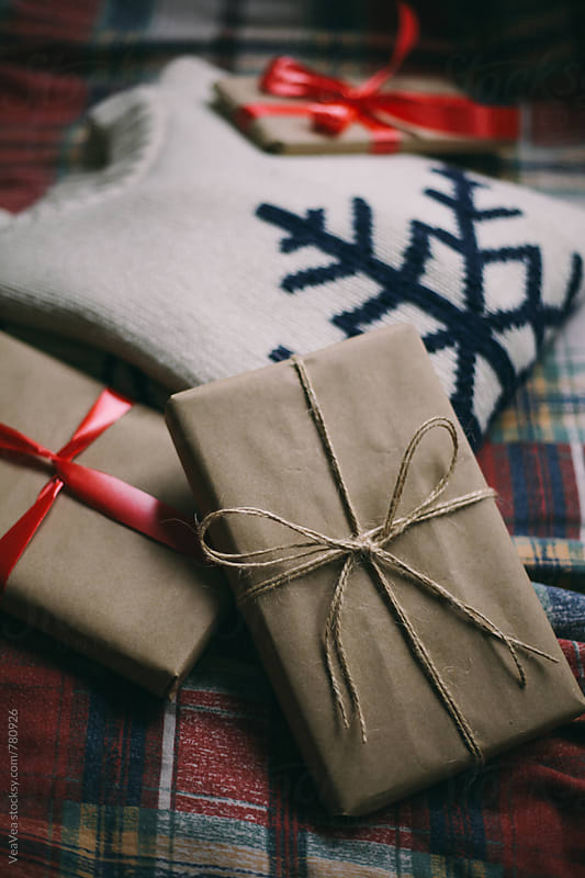 Christmas gifts and sweater on a natural light  by VeaVea for Stocksy United
