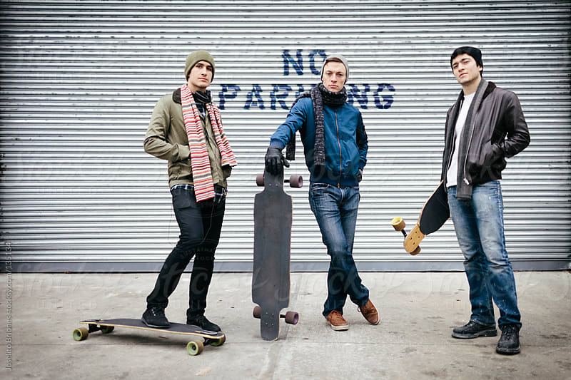 Friends Posing for Portrait with Skateboard in Brooklyn by Joselito Briones for Stocksy United