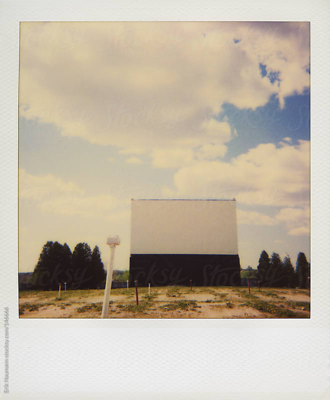 Polaroid of a drive-in theatre by Erik Naumann for Stocksy United