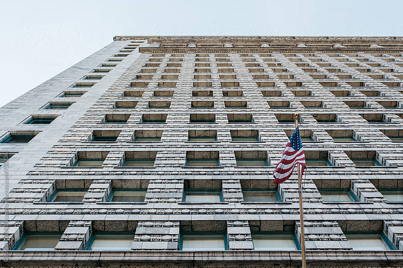 USA flag on a tall building in Chicago by Gabriel (Gabi) Bucataru for Stocksy United