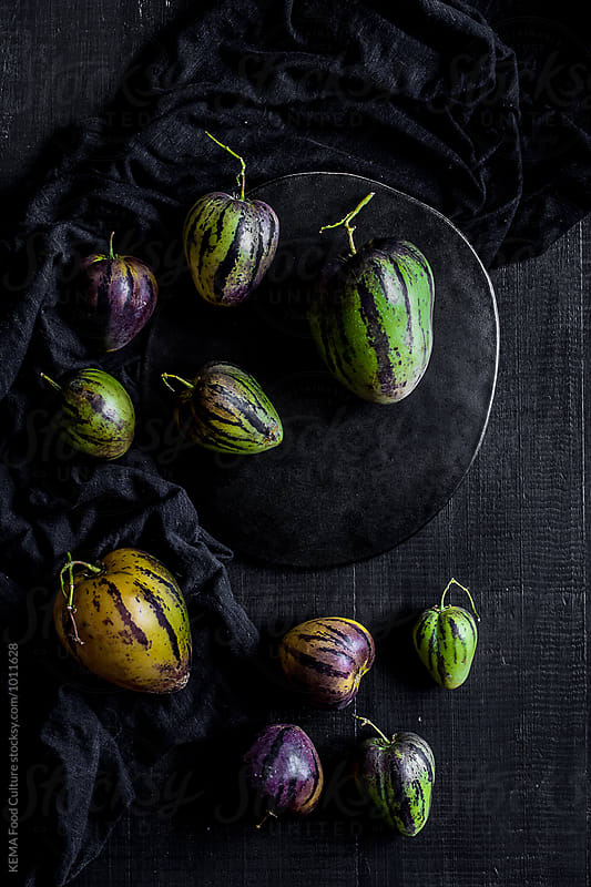 Pear-melons on a wooden  table  by KEMA Food Culture for Stocksy United