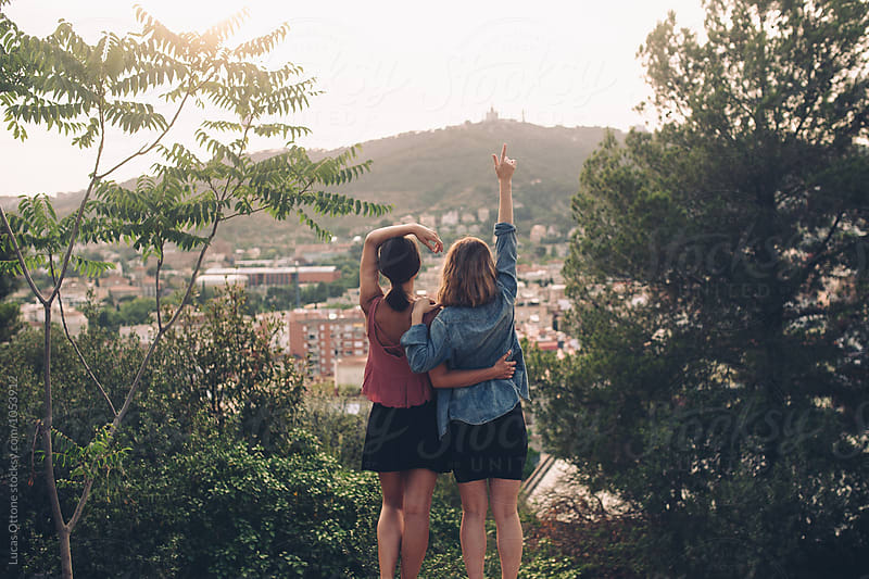 Two girl friends looking at the city by Lucas Ottone for Stocksy United