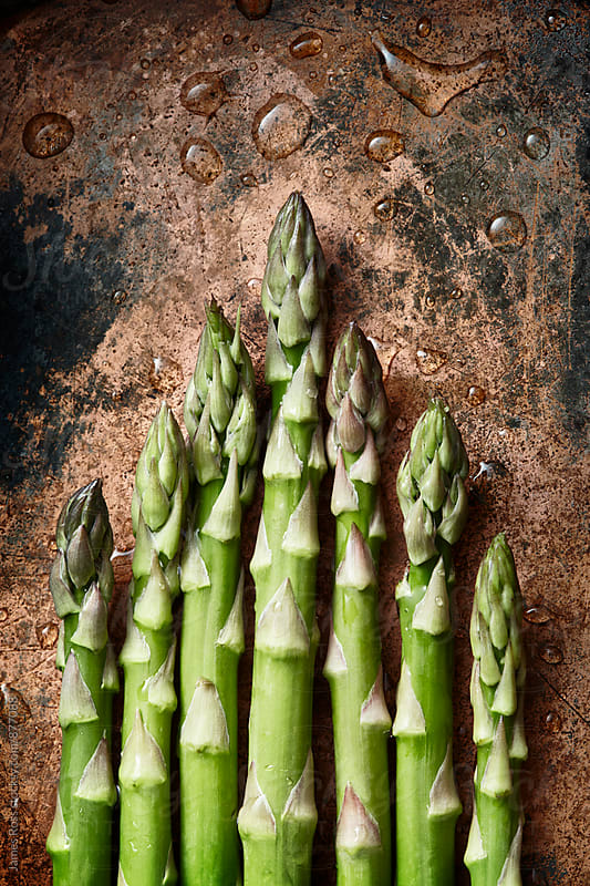 Green asparagus tips by James Ross for Stocksy United