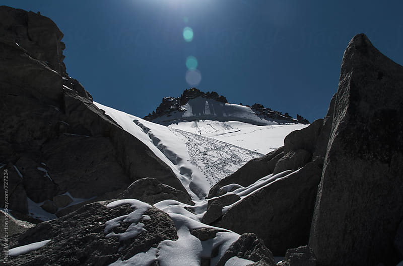 Distant Alpinists on mountain glacier by Neil Warburton for Stocksy United