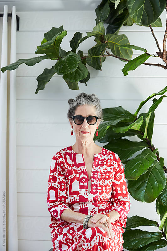 Portrait of stylish senior woman at home by Trinette Reed for Stocksy United