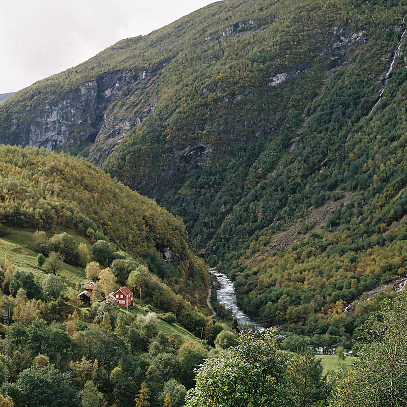 A red cabin in the valley of Utladalen in Norway by Atle Rønningen for Stocksy United