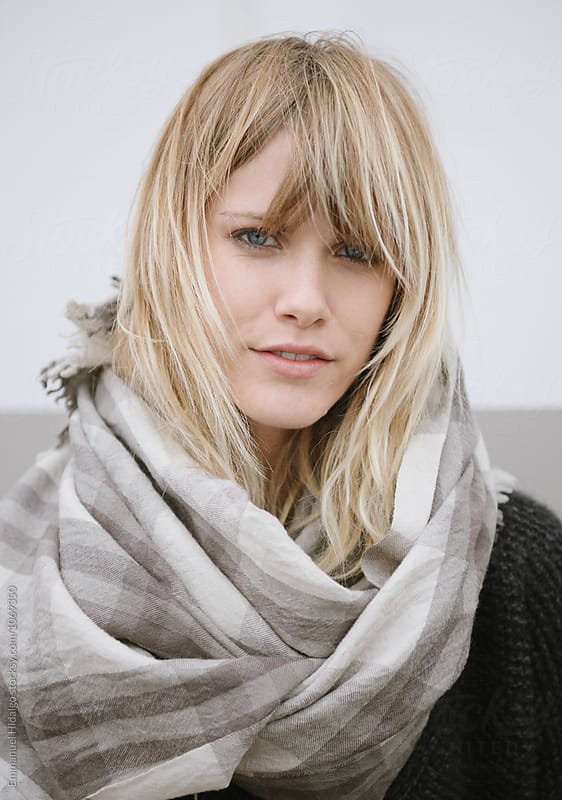 Portrait of a young woman wearing a cool scarf by Emmanuel Hidalgo for Stocksy United