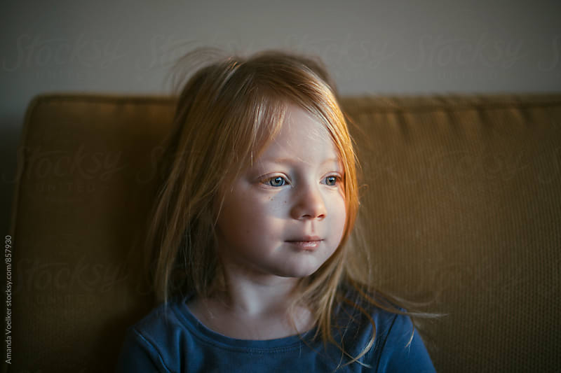 Portrait of Little Girl In the Morning Light by Amanda Voelker for Stocksy United