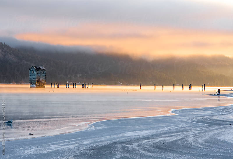 Sunrise over frost-covered beach in winter by Mihael Blikshteyn for Stocksy United