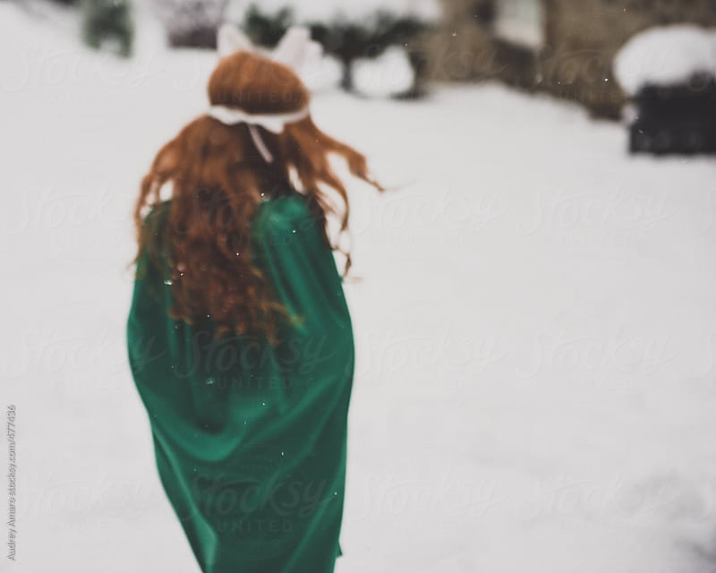 Girl walks away in the snow by Audrey Amaro for Stocksy United
