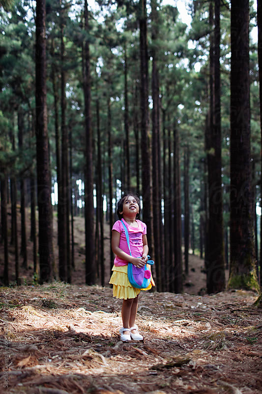 Little girl alone in the forest by Saptak Ganguly for Stocksy United