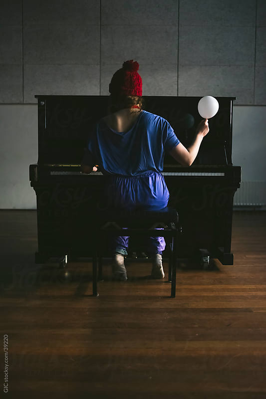 Hipster girl playing piano with a balloon by GIC for Stocksy United