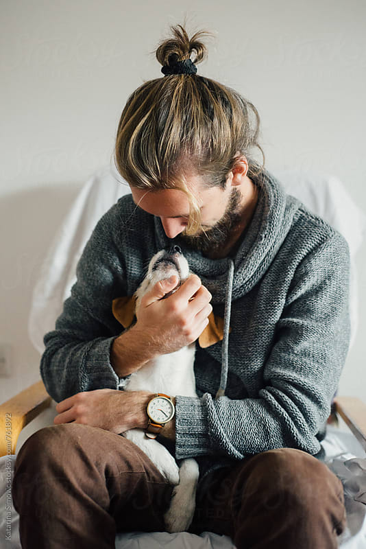 Man hugging his dog by Katarina Simovic for Stocksy United