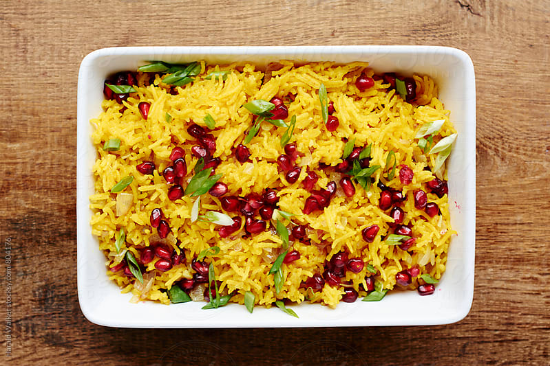 Spicy Yellow Rice with Pomegranae Arils by Harald Walker for Stocksy United