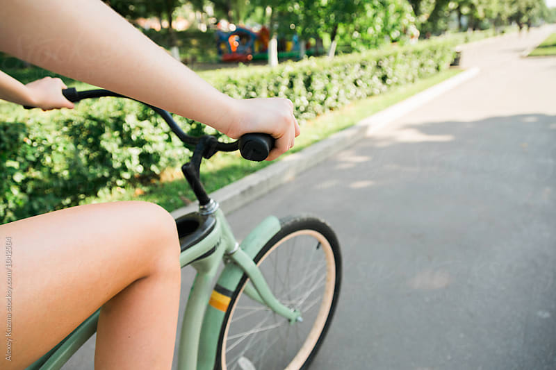 Young Woman Riding a Bike in the Park by Alexey Kuzma for Stocksy United
