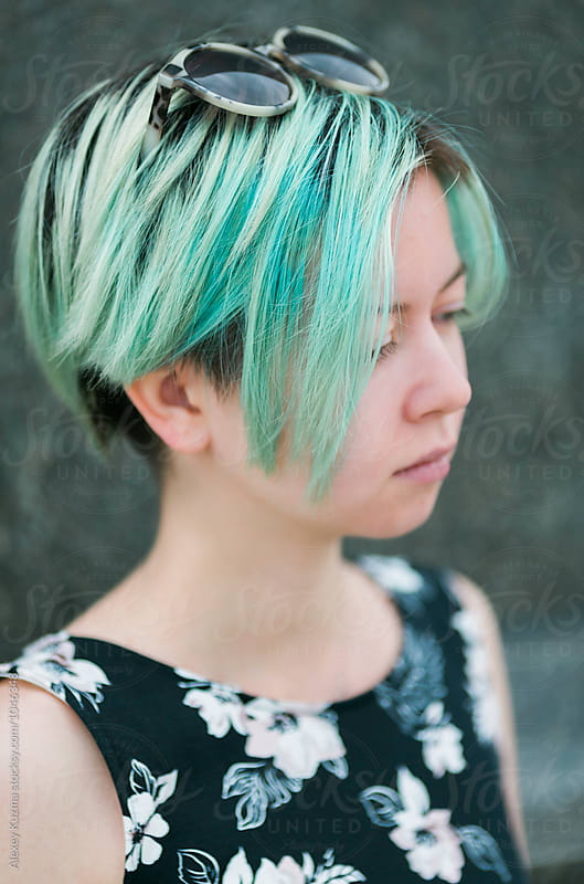 closeup of young woman with green pastel colors by Vesna for Stocksy United
