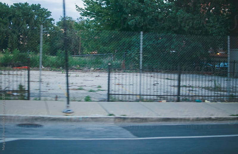 speeding past a vacant lot by Margaret Vincent for Stocksy United
