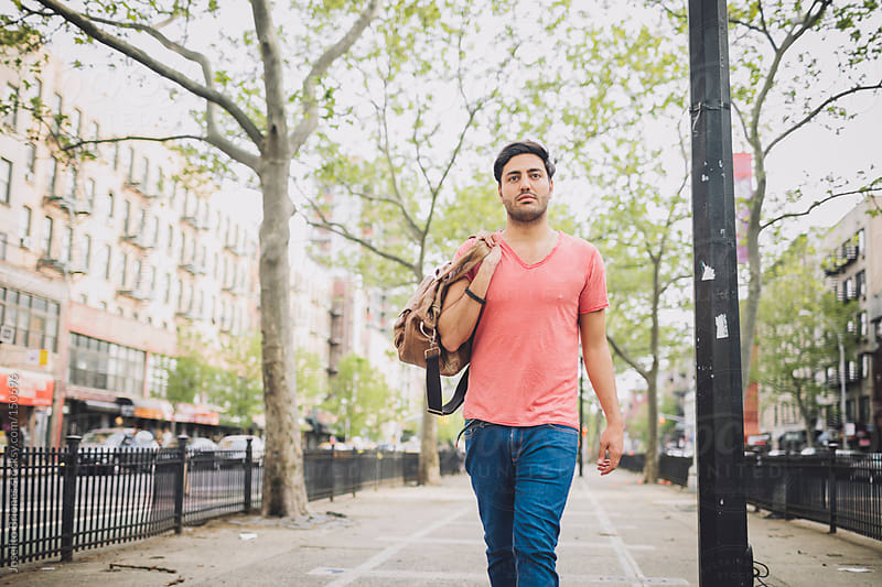 Portrait of Casual Man at Urban Park by Joselito Briones for Stocksy United