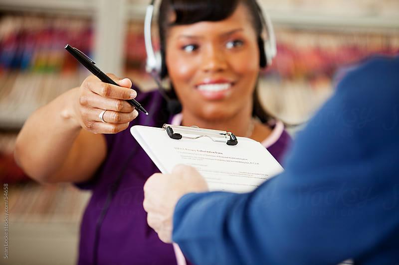 Waiting Room: Focus on HIPAA Form by Sean Locke for Stocksy United
