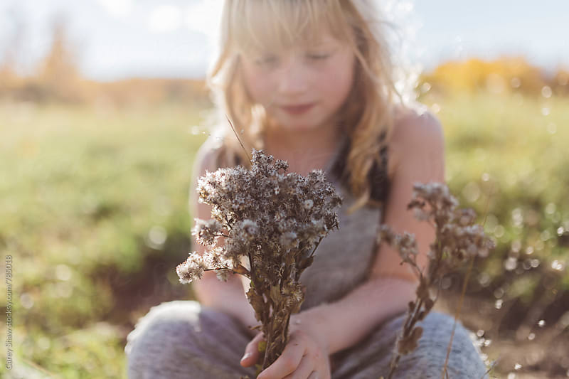 Young girl holding wild bouquet of flowers by Carey Shaw for Stocksy United