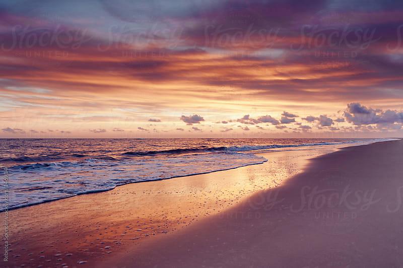 Sunset beach by Rebecca Spencer for Stocksy United